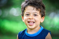 Happy mulatto boy child is smiling enjoying adopted life. Royalty Free Stock Photo
