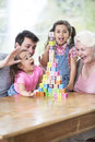 Happy multi generation family with arranged building blocks at table in house Stock Photos
