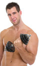Happy muscular man raising dumbbell Royalty Free Stock Photo