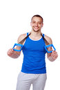 Happy muscular sportsman with expanders Royalty Free Stock Photo