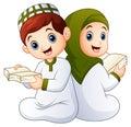 Happy Muslim kid holding Quran
