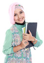 Happy muslim student portrait holding a few books of isolated over white background Royalty Free Stock Photo