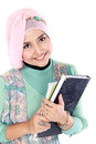 Happy muslim student portrait holding a few books of isolated over white background Royalty Free Stock Images