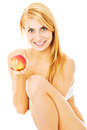 Happy naked woman holding apple over white background portrait of semi dressed while sitting isolated Stock Image