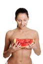 Happy, naked woman is looking at watermelon. Royalty Free Stock Photo