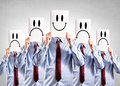 Happy and negative faces businessmen holdings blank papper over their heads with Stock Photo