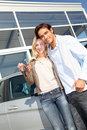 Happy new car owners Stock Photo