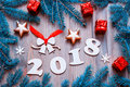 Happy New Year 2018 background with 2017 figures, Christmas toys, blue fir tree branches. New Year 2018 still life Royalty Free Stock Photo