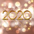 Happy New Year background with gold lettering and bokeh lights design