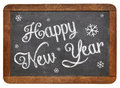 Happy new year on blackboard white chalk text a vintage slate Stock Photos