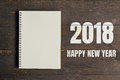 Happy New Year 2018 and Brown note book open on wood table backg Royalty Free Stock Photo