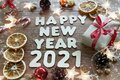 Happy new year 2021. Christmas composition. New year`s layout on a dark wooden background. Cones, toys, gift, garland Royalty Free Stock Photo