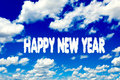 Happy new year clouds sign on clear blue sky Stock Images