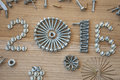 Happy new year composition with screws nails bolts and dowels background Royalty Free Stock Photo
