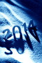 Happy new year date made from wooden numbers in blue snow with long shadow Royalty Free Stock Image