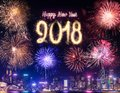 Happy new year 2018 firework over cityscape building near sea at Royalty Free Stock Photo