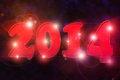Happy new year glowing red over black background Stock Photos
