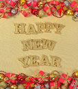 Happy New Year golden text and Christmas decorations Royalty Free Stock Photo