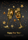 Happy New Year greeting card with gold drinking glasses. Holiday black glowing background.