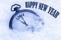 Happy new year greeting card pocket watch in snow Royalty Free Stock Photo