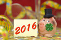 Happy new year with lucky charm pig made marzipan as and clover leaf Royalty Free Stock Photo