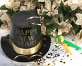 Happy New Year with noise makers and holiday flowe Royalty Free Stock Images