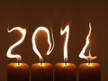 Happy new year pf modified photo of four candles flames write numbers Royalty Free Stock Image