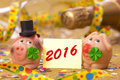Happy new year with pig as lucky charm made marzipan and clover leaf for success Stock Images