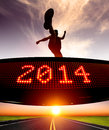 Happy new year runner jumping and crossing over matrix display for celebrating Stock Image
