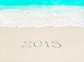 Happy New Year 2015 season concept on azure tropical sandy beach Royalty Free Stock Photo