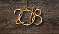2018 Happy New Year seasonal background with real wood green pine Royalty Free Stock Photo