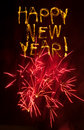 Happy New Year sparklers with pink fireworks Royalty Free Stock Photo