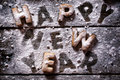 Happy new year text with cookies on the wooden background Royalty Free Stock Photo