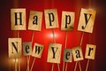 Happy new year text cut out letters Royalty Free Stock Photography