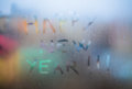 Happy new year text handwritten on a misted window Stock Photo