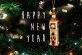 Happy new year text sign on Queen`s guard near big ben christmas Royalty Free Stock Photo