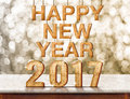 Happy New Year 2017 wood texture on marble table with sparkling Royalty Free Stock Photo