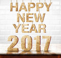 Happy New Year 2017 wood texture on marble table with white cera Royalty Free Stock Photo