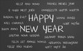 Happy new year word cloud in many different languages written on a chalkboard Stock Photos