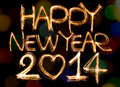 Happy new year written with sparkling figures on bokeh background Royalty Free Stock Photos