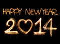 Happy new year written with sparkling figures on bokeh background Stock Photo