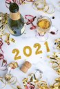 Happy New Year 2021. New Years Eve celebration concept background.Champagne bottle with glass and confetti Royalty Free Stock Photo