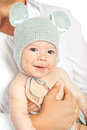 Happy newborn baby with crochet cap boy mouse in mother hands Royalty Free Stock Images