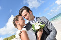 Happy newly weds in love looking at each other bride and groom others eyes Stock Images