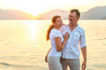 Happy newlyweds embracing at the seaside Royalty Free Stock Photo