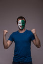 Happy northern irishman football fan pray for northern ireland national team on grey background european fans concept Stock Photography