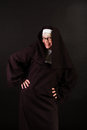 Happy nun a with hands on her hips Stock Photo