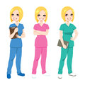Happy nurse posing beautiful blonde in three different color scrubs uniform Stock Images