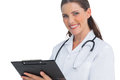 Happy nurse smiling at camera and holding clipboard Royalty Free Stock Photo