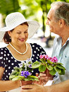 Happy old couple with flower outdoor Stock Photo